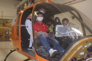 C3 Youth and Staff completely immersed in Bell Flight's aircraft simulators